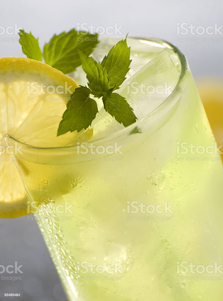 A drink with a slice of lemon on the glass royalty-free stock photo