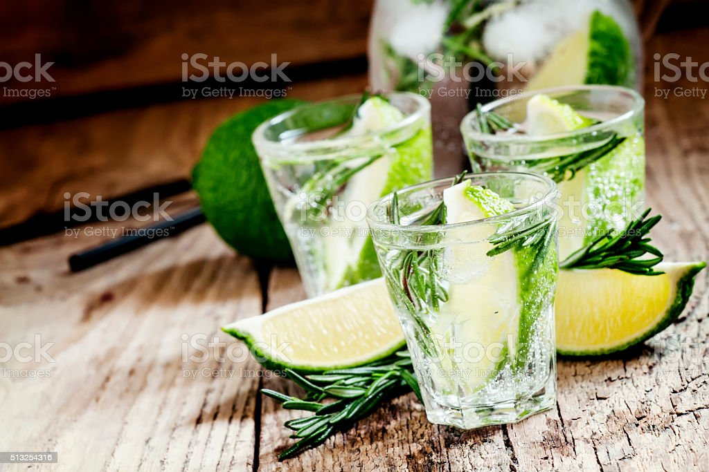 Drink with lime, rosemary, honey and soda stock photo