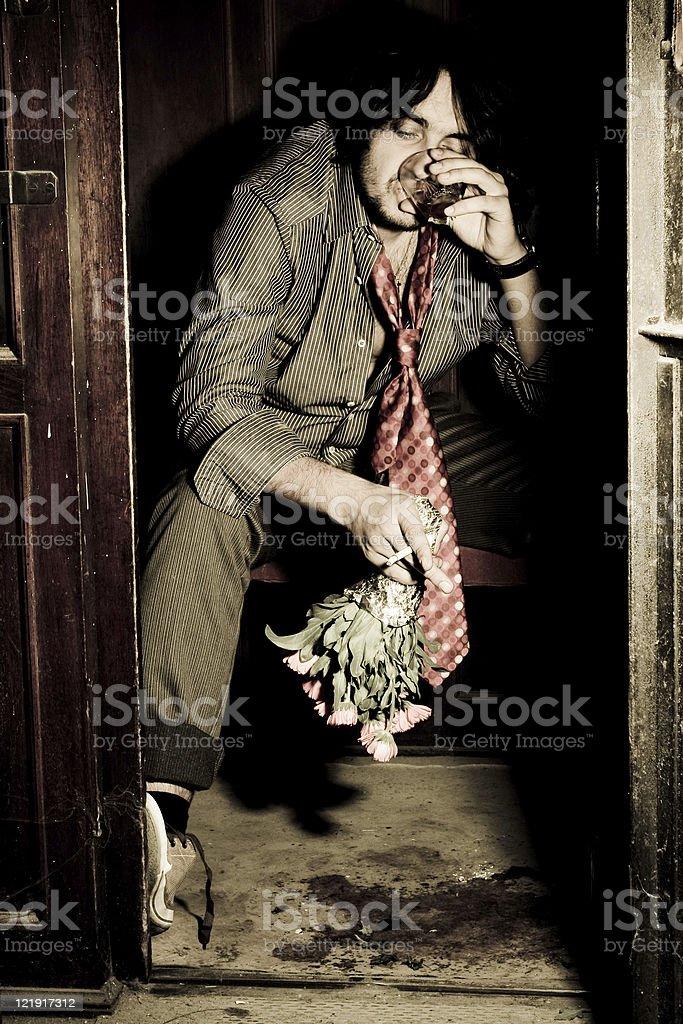 Drinker in old elevator - series royalty-free stock photo