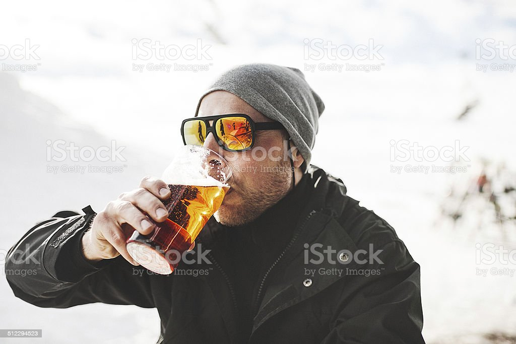 Drinking a beer at after ski stock photo