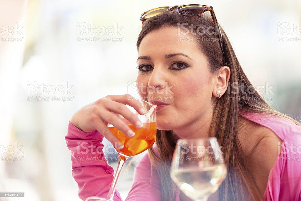 drinking a cocktail at bar royalty-free stock photo