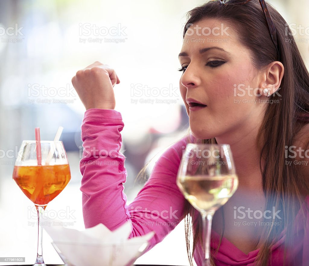 drinking a cocktail at bar royalty-free stock photo