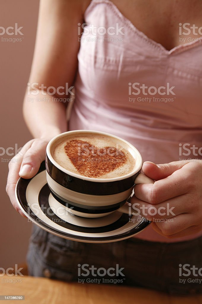 Drinking a cup of coffee with love stock photo