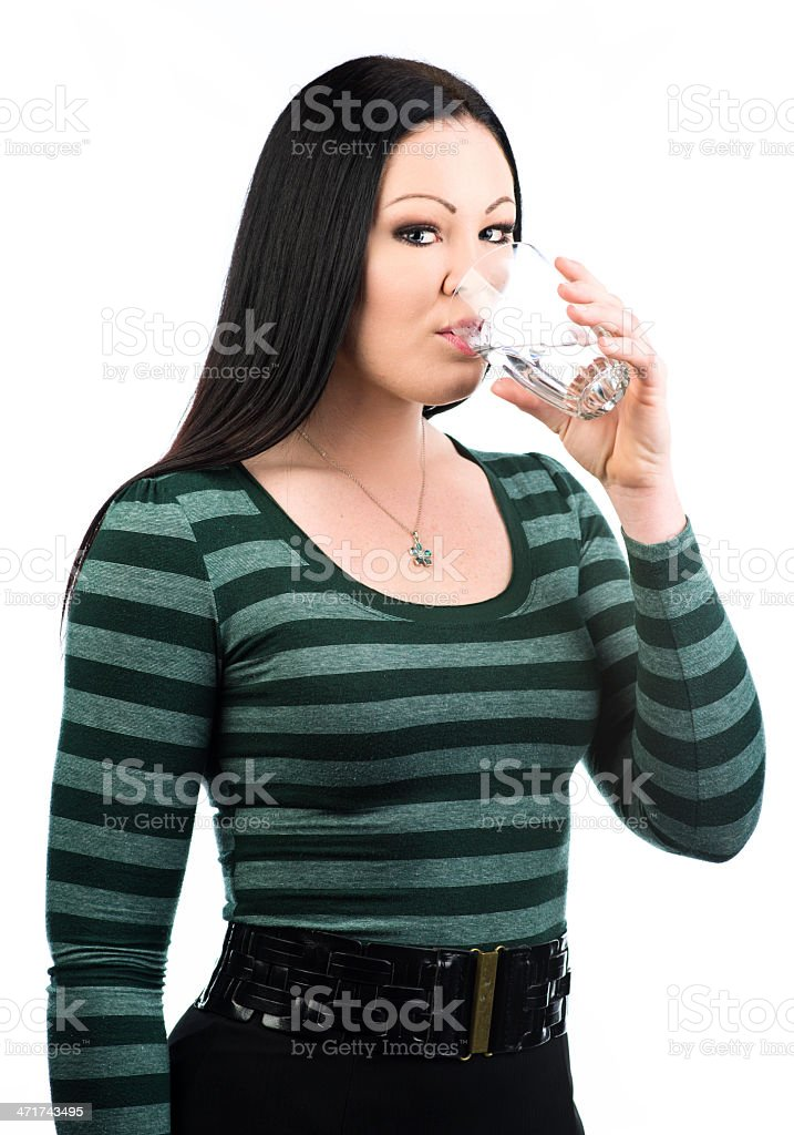 Drinking a glass of water royalty-free stock photo