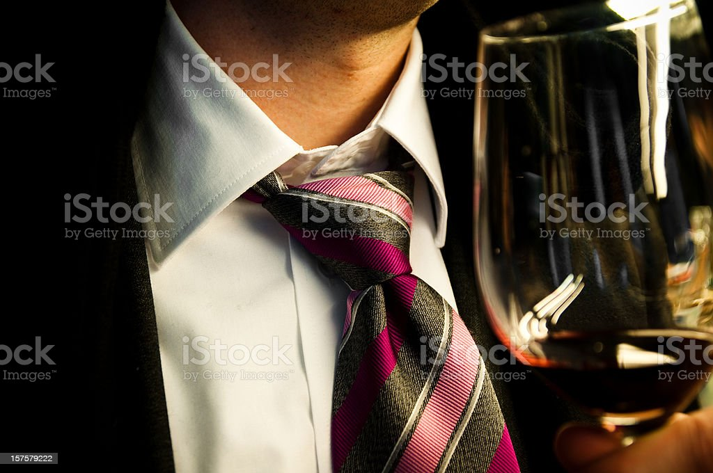 drinking a glass of wine after work stock photo