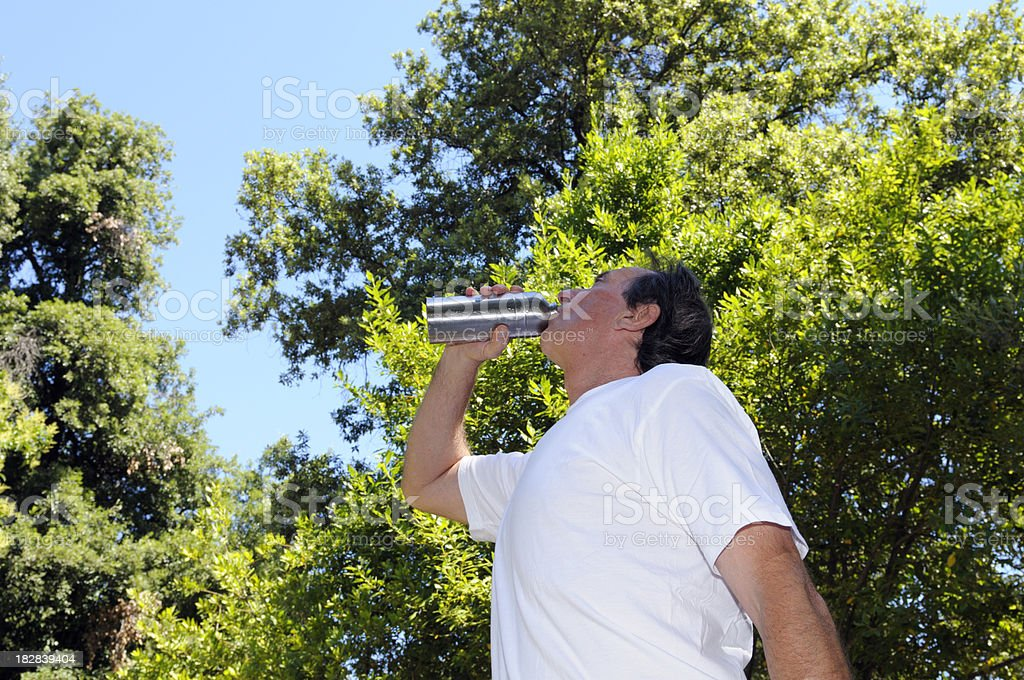 drinking after jogging royalty-free stock photo