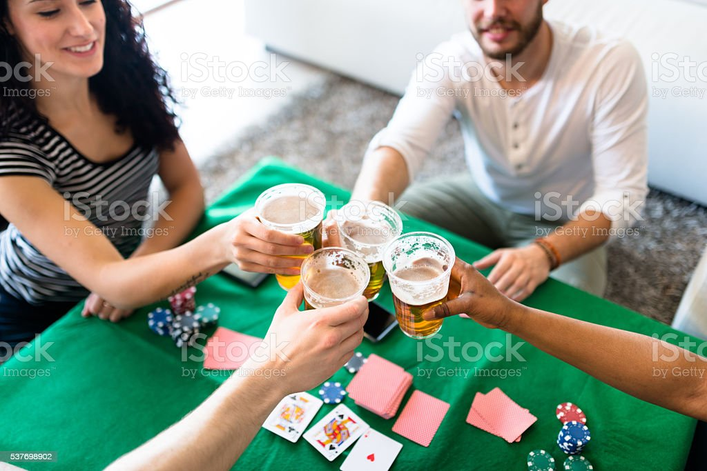 drinking and playing poker stock photo