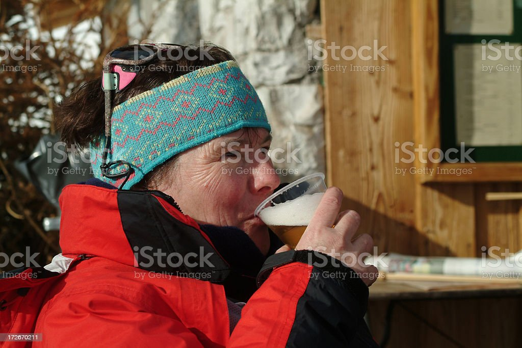 Drinking beer after skiing royalty-free stock photo