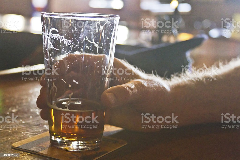 Drinking Beer At the Bar stock photo