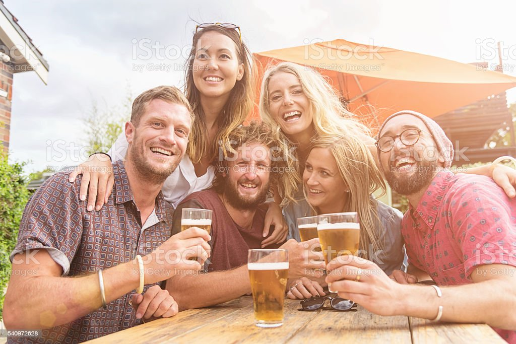 Drinking Beer Group of Friends Together BBQ Party Australia stock photo