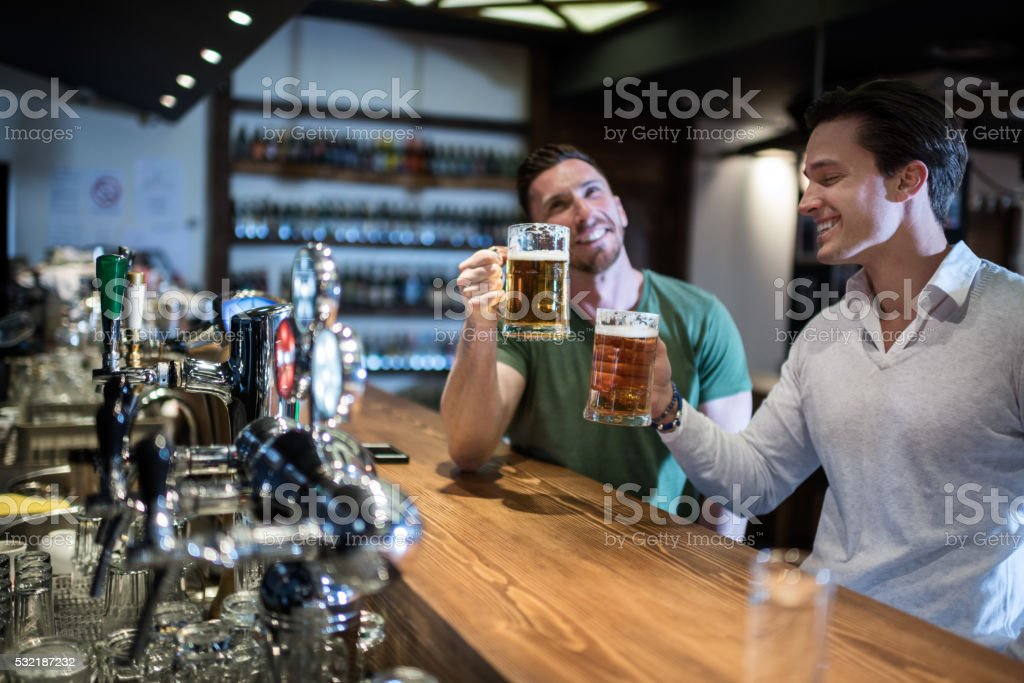 Drinking beer in the pub stock photo