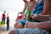 Drinking beer on beach