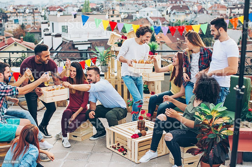 Drinking beer on the rooftop stock photo