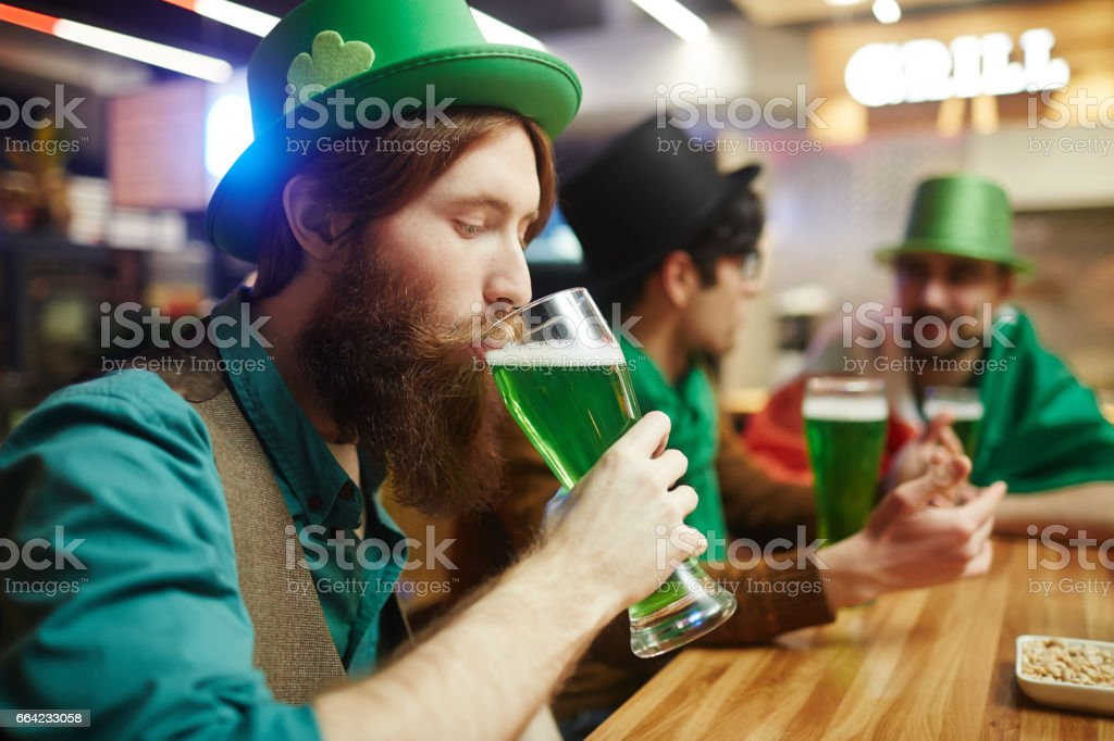 Drinking beer stock photo