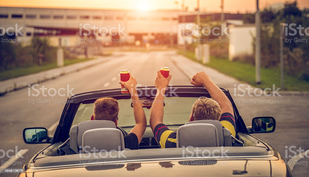 Drinking beer while driving stock photo