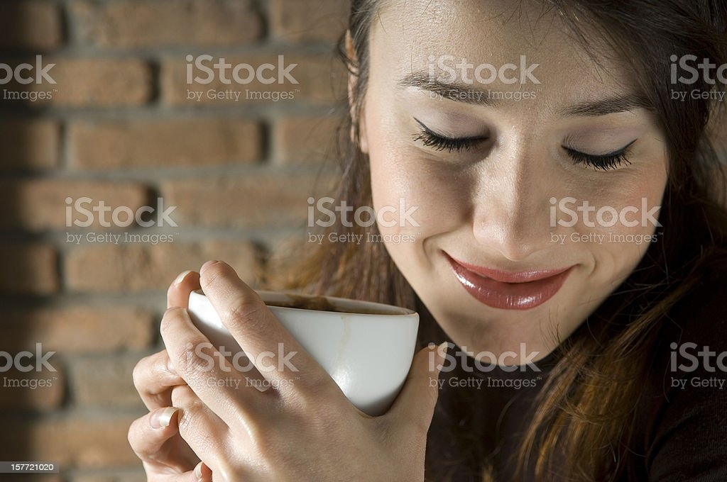 Drinking Cappuccino royalty-free stock photo