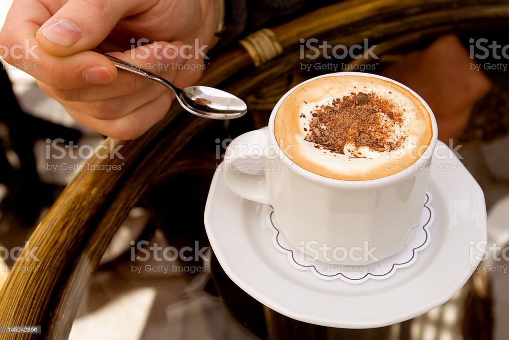 Drinking capuccino royalty-free stock photo