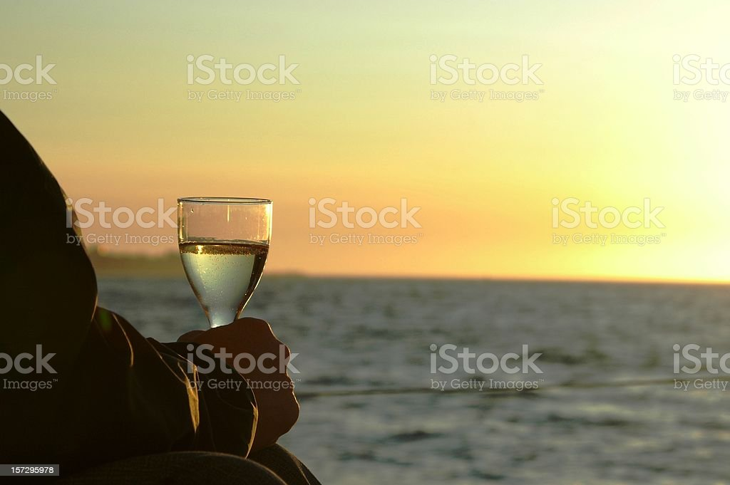 Drinking champagne on a yacht (silhouette) royalty-free stock photo