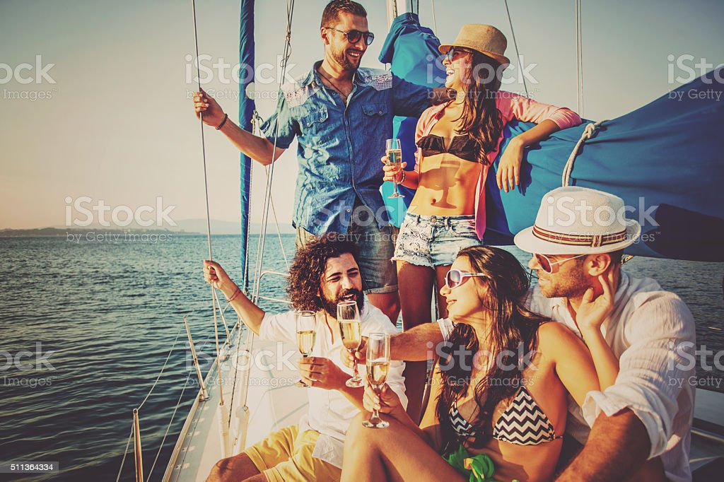 Drinking champagne on a yacht stock photo