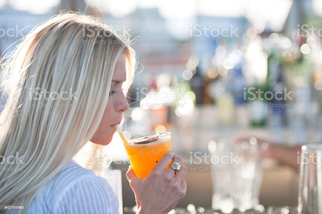 Drinking cocktail stock photo