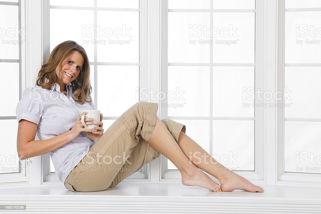 Drinking Coffe in the Window stock photo
