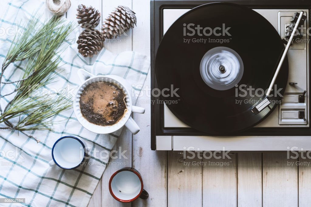 Drinking coffee and playing records stock photo