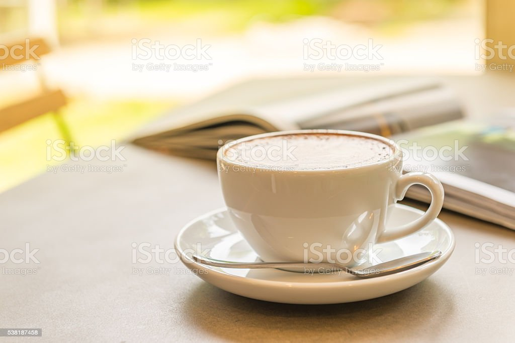 drinking coffee and reading books stock photo