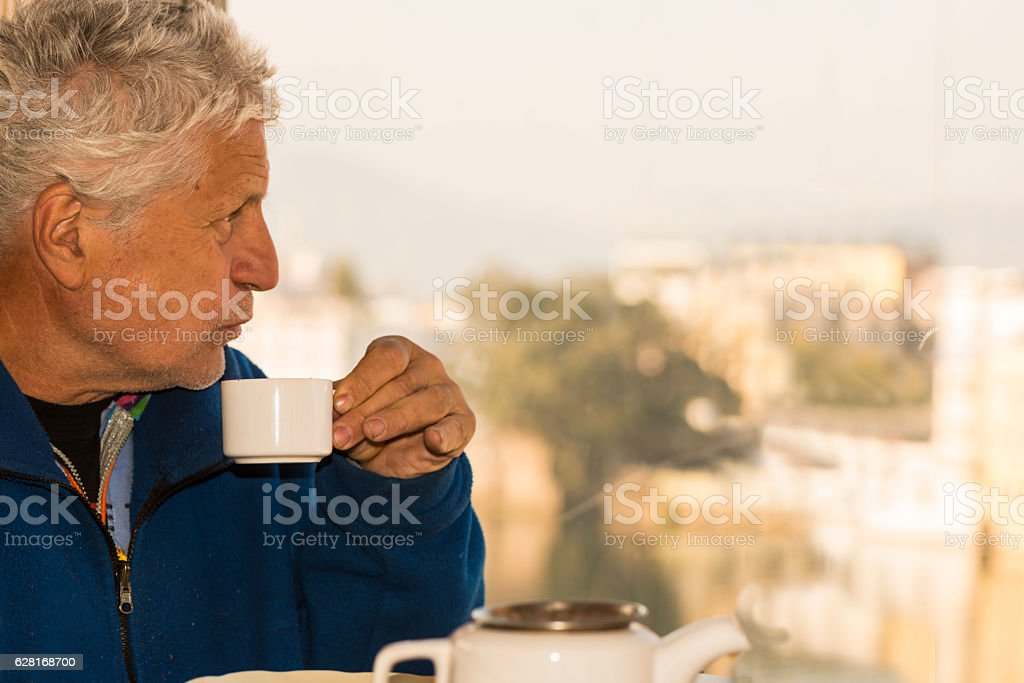 Drinking coffee at the Lake Pichola stock photo