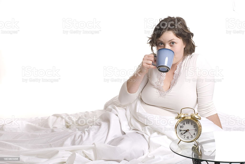 Drinking Coffee In Bed royalty-free stock photo