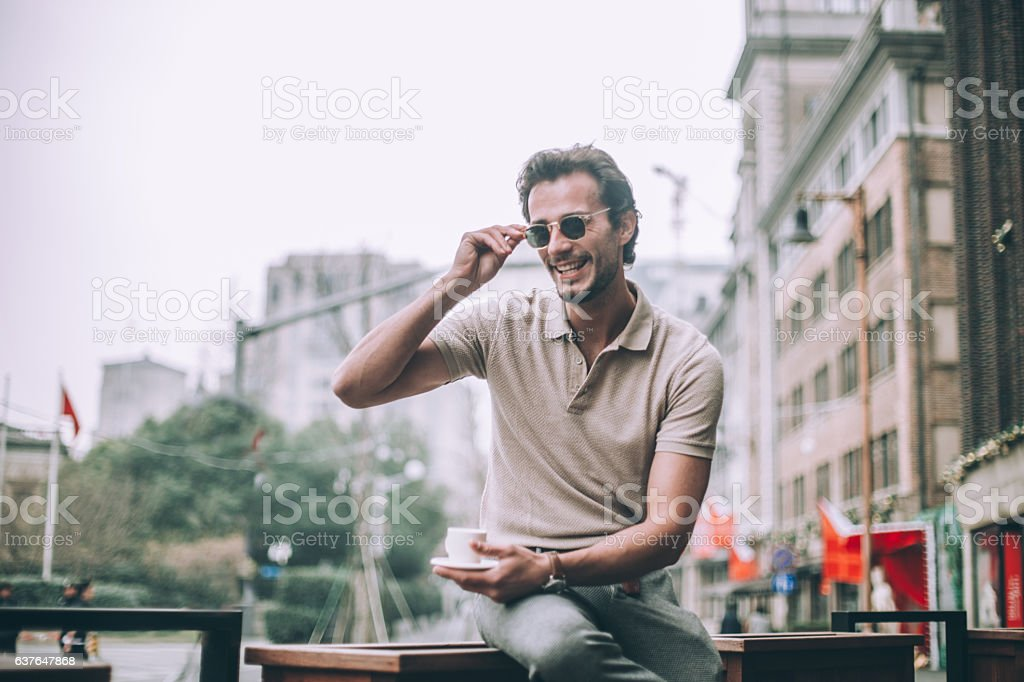 Drinking coffee outdoors stock photo