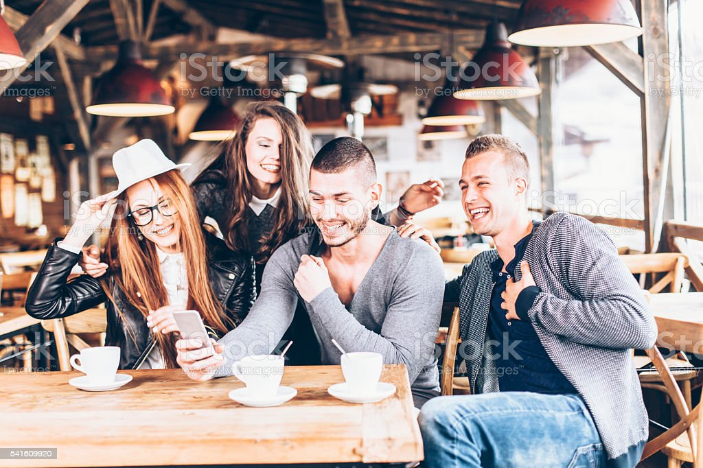 Drinking coffee together and having fun stock photo