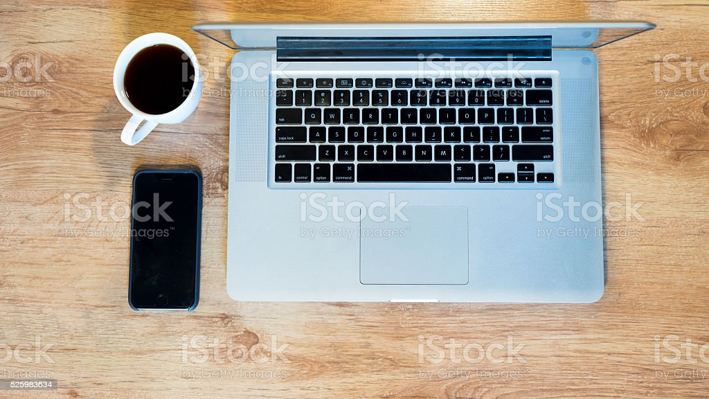 Drinking coffee with laptop and smart phone royalty-free stock photo