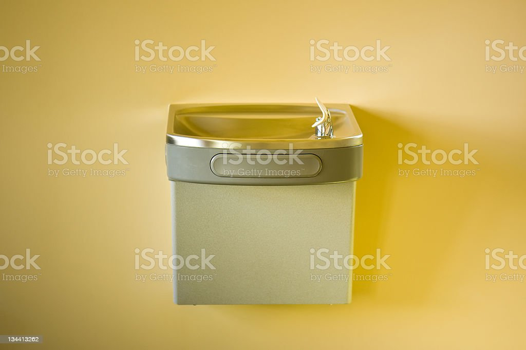 Drinking Fountain on Yellow Wall stock photo