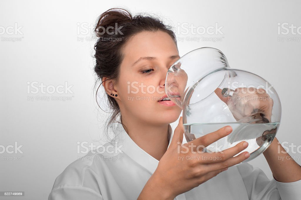 Drinking girl with a glass  pitcher in a hands stock photo