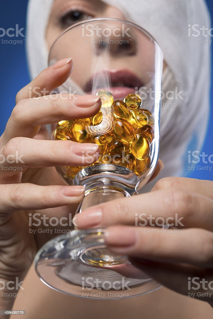 drinking her pills royalty-free stock photo