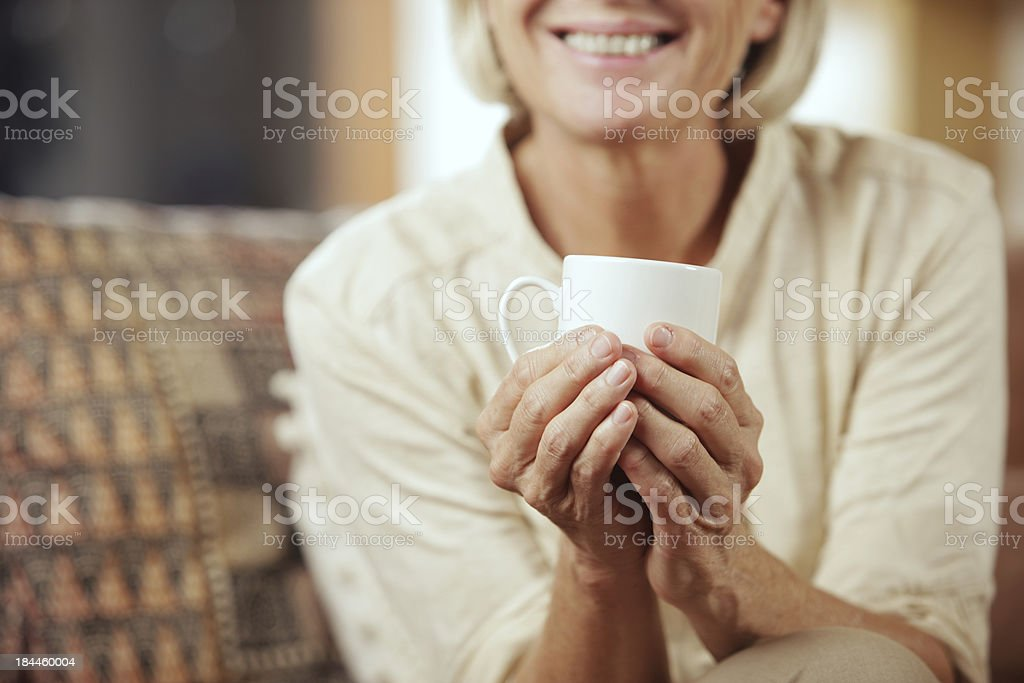 Drinking hot beverage royalty-free stock photo