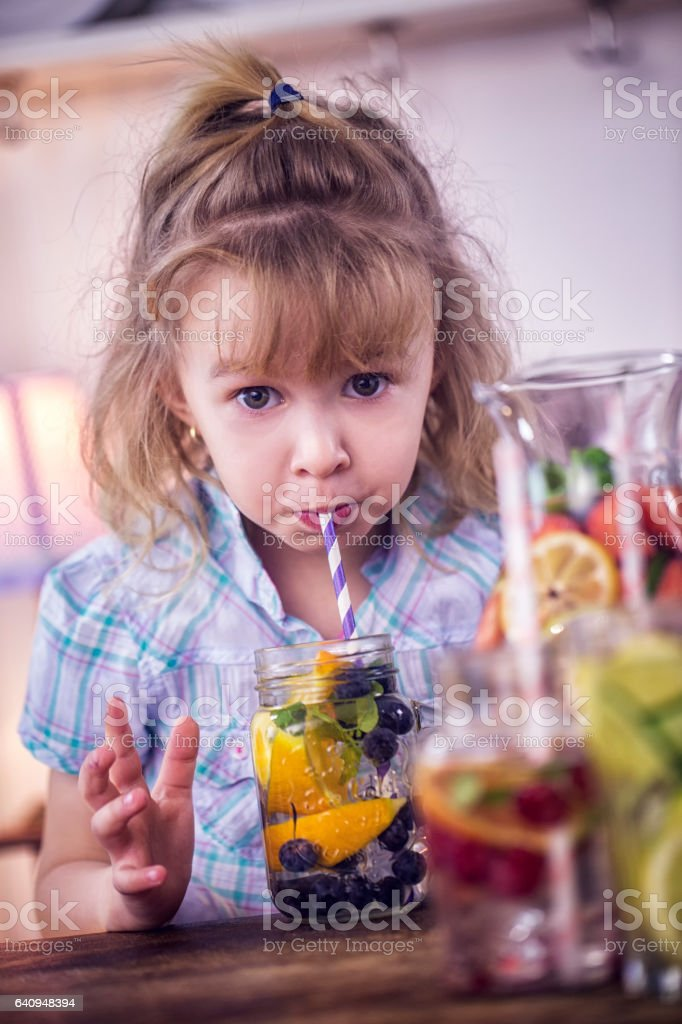 Drinking Infused Water with Fresh Blueberries and Oranges stock photo