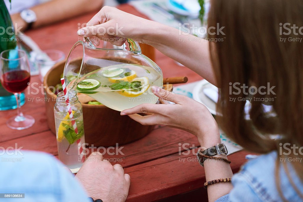 Drinking lemonade stock photo