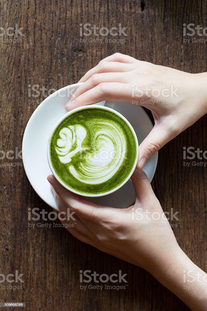 Drinking matcha Latte stock photo
