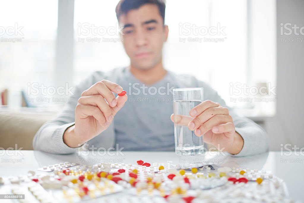 Drinking medicine stock photo