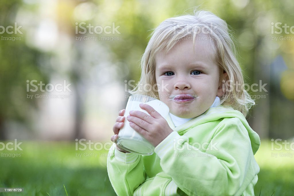 Drinking milk outside is tastier stock photo