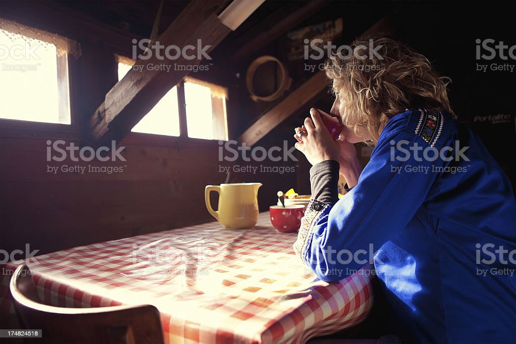 Drinking Morning Coffee in Swiss Chalet stock photo