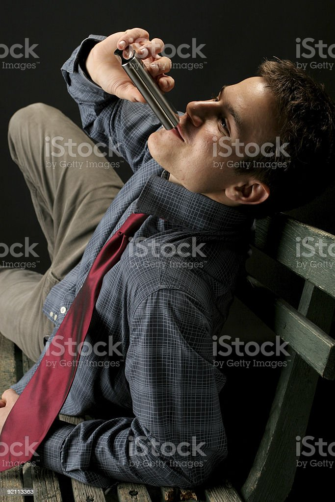 Drinking on a park bench royalty-free stock photo