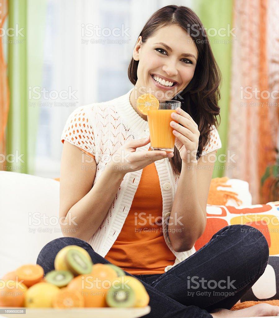 Drinking orange juice royalty-free stock photo