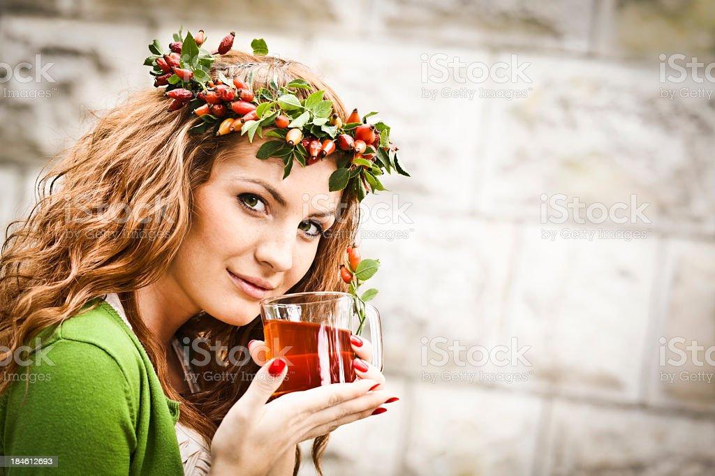 Drinking rosehip juice royalty-free stock photo