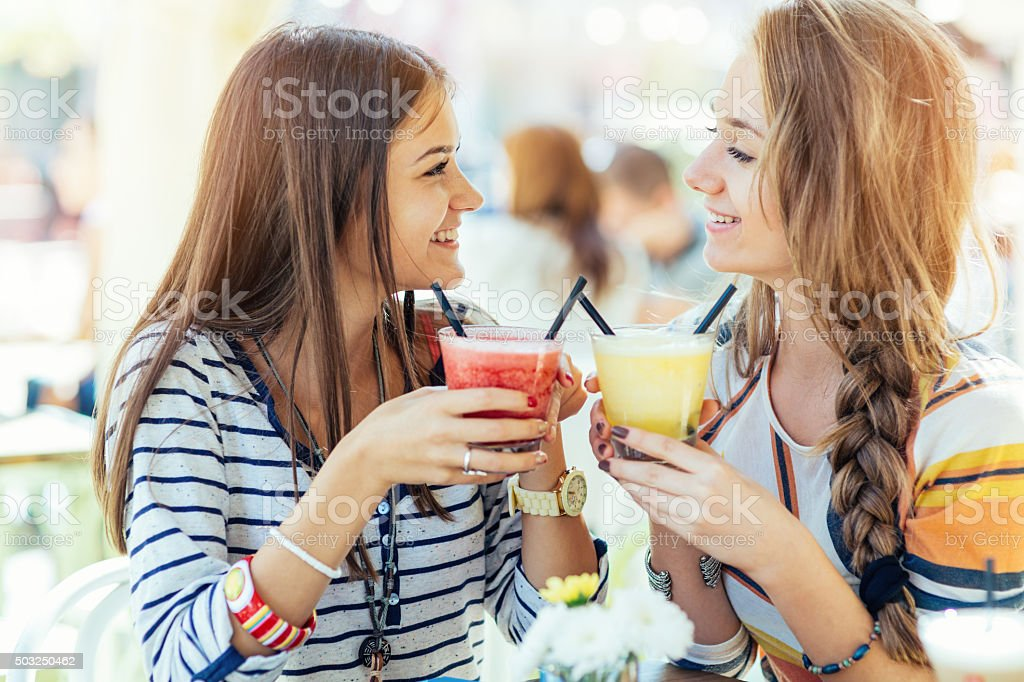 Drinking smoothies stock photo