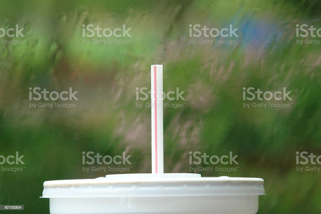 Drinking Straw Against Rain-Spattered Window royalty-free stock photo