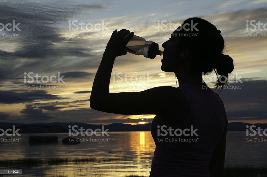Drinking Sunset Jogging royalty-free stock photo
