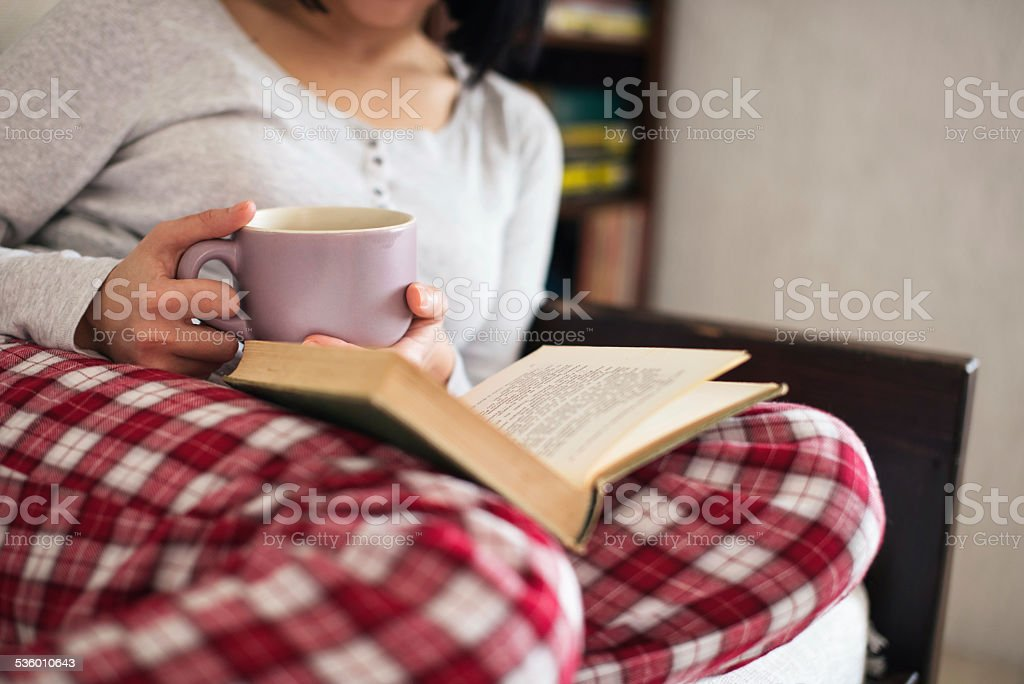 Drinking tea and reading book stock photo