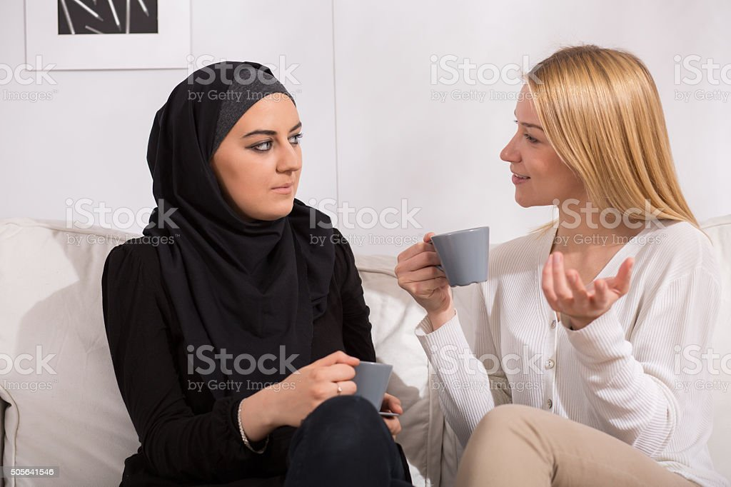 Drinking tea with muslim stock photo